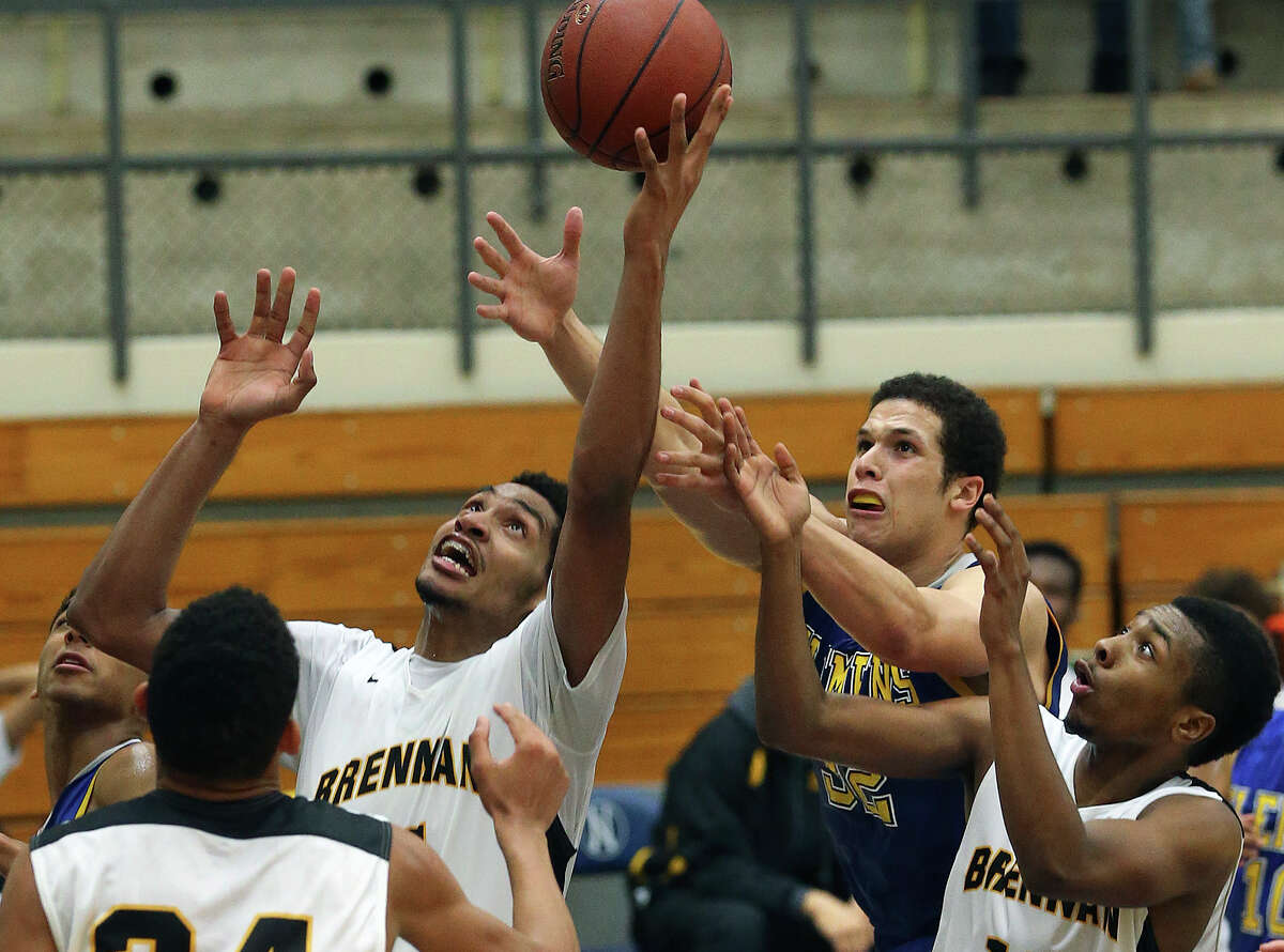 Jordan Murphy controls the ball before Cayne Edwards can move in as Brennan plays Clemens at Taylor Field House on Dec. 20, 2014.