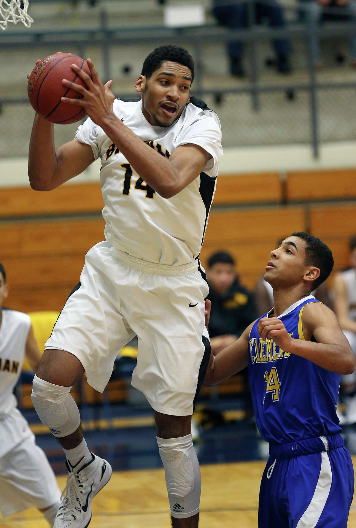 Jordan Murphy pulls down a rebound in front of Devin Kearns as Brennan plays Clemens at Taylor Field House on Dec. 20, 2014.