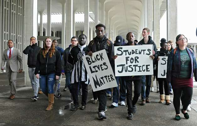 Students and local elected officials hold a demonstration march around the campus podium at the University at Albany on Thursday, April 9, 2015 in Albany, N.Y. The awareness rally shows concern for an Arbor Hill event that led to the death of Donald Ivy. (Lori Van Buren / Times Union) Photo: Lori Van Buren / 00031354A