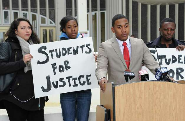 Jarius Jemmott, president-elect, University at Albany Student Association, speaks before students and local elected officials hold a demonstration march around the campus podium at the University at Albany on Thursday, April 9, 2015 in Albany, N.Y. The awareness rally shows concern for an Arbor Hill event that led to the death of Donald Ivy. (Lori Van Buren / Times Union) Photo: Lori Van Buren / 00031354A