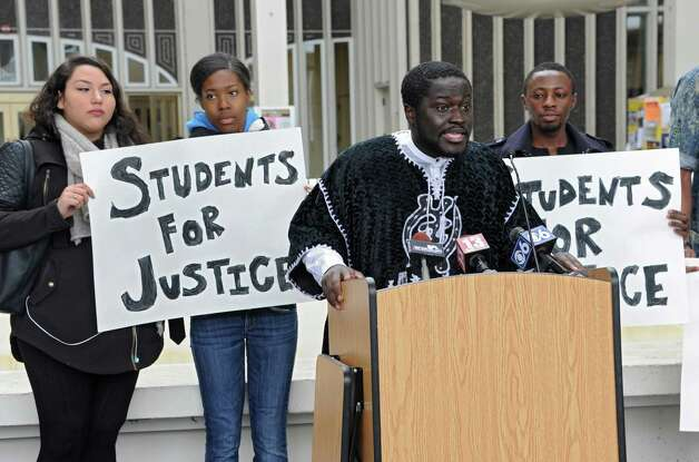 Francis Agyemang, president, University at Albany Student Association, speaks before students and local elected officials hold a demonstration march around the campus podium at the University at Albany on Thursday, April 9, 2015 in Albany, N.Y. The awareness rally shows concern for an Arbor Hill event that led to the death of Donald Ivy. (Lori Van Buren / Times Union) Photo: Lori Van Buren / 00031354A