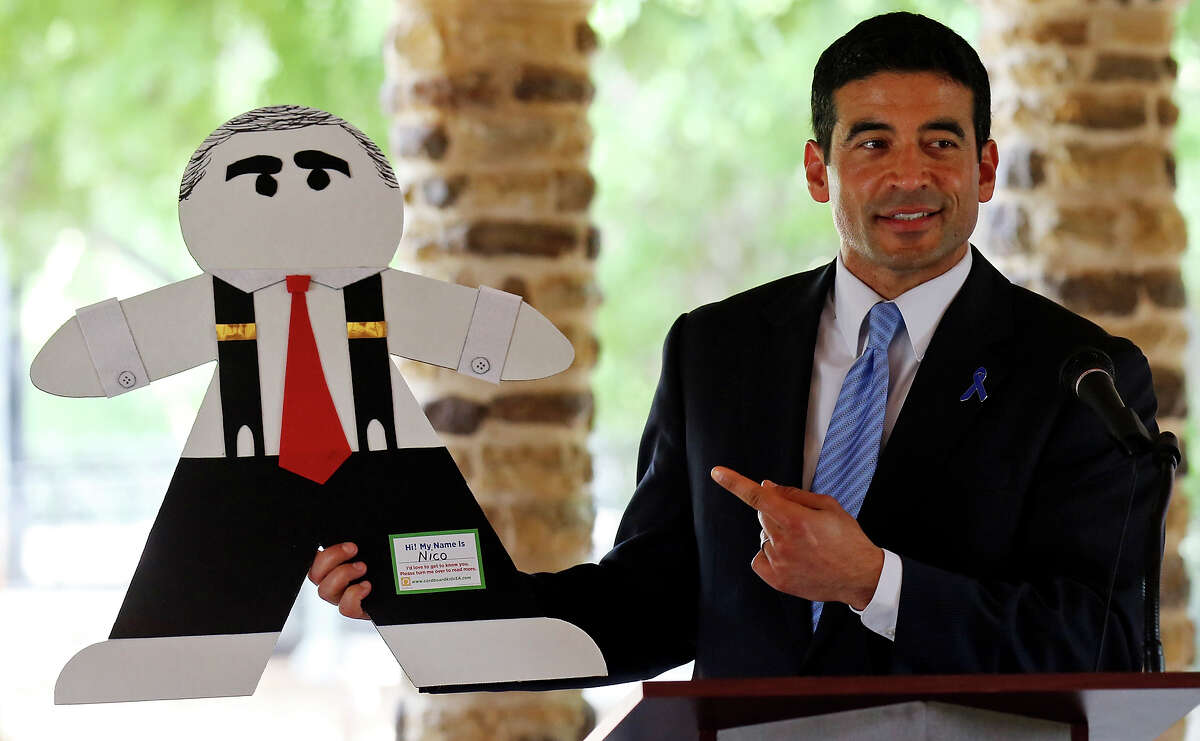 Bexar County District Attorney Nico LaHood shows his Cardboard Kid while speaking during a press conference held Thursday April 9, 2015 at the Joske Pavilion in Brackenridge Park. April is National Child Abuse Prevention month.