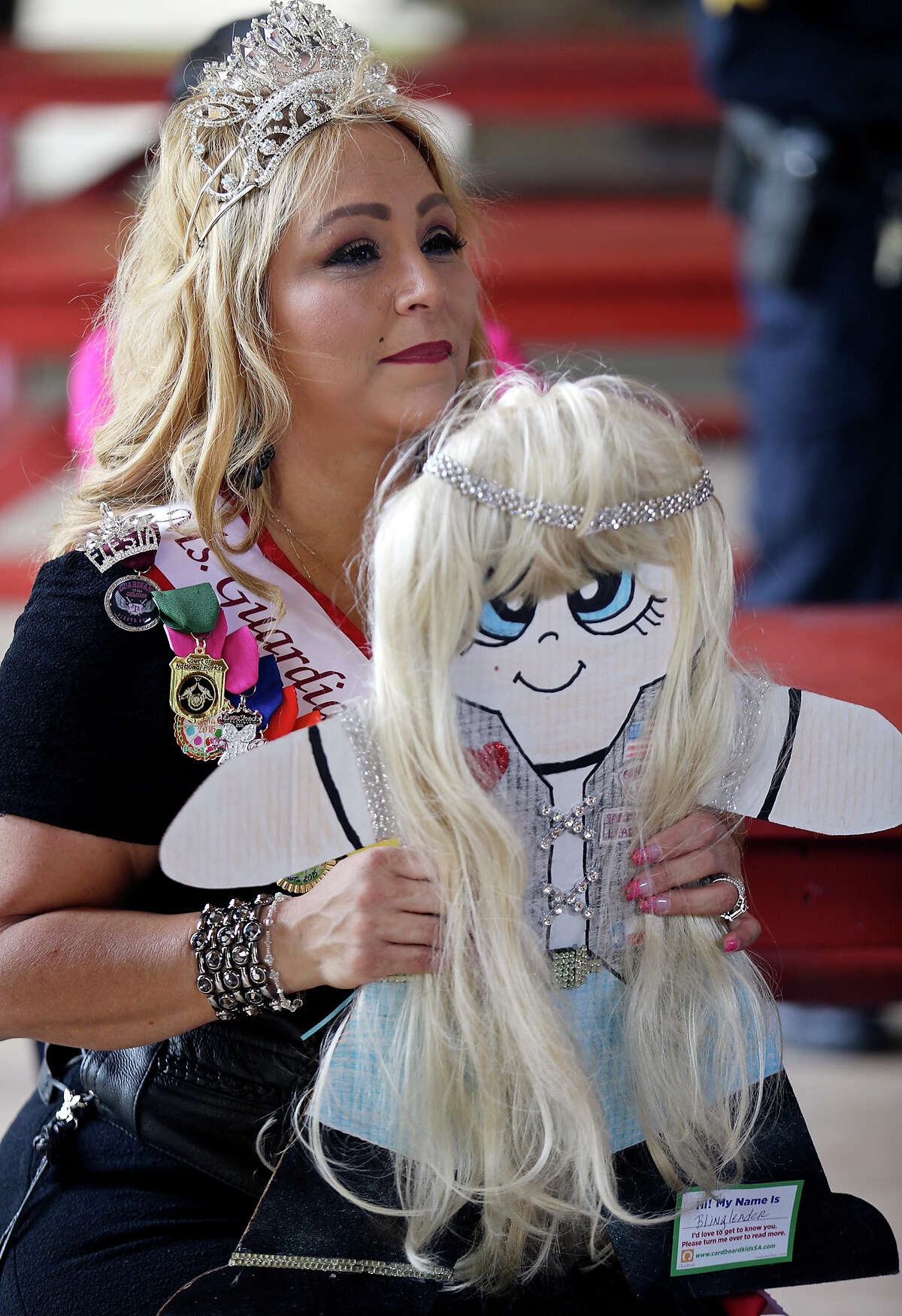 """Guardians of the Children Von Ormy chapter member Cindi """"Bling Leader"""" Segura holds her Cardboard Kid while listening to speakers during a press conference held Thursday April 9, 2015 at the Joske Pavilion in Brackenridge Park. April is National Child Abuse Prevention month."""