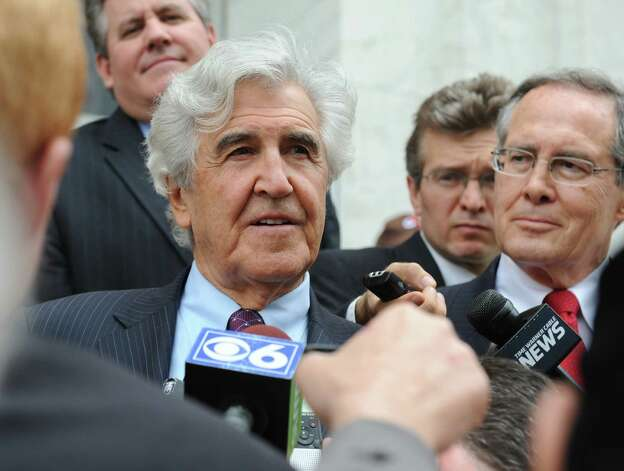 Former State Senate Majority Leader Joseph Bruno talks to the media outside the James T. Foley U.S. Courthouse following Bruno's not guilty verdict on federal corruption charges Friday, May 16, 2014, in Albany, N.Y. Defense attorney E. Stewart Jones smiles at right. (Lori Van Buren / Times Union) Photo: Lori Van Buren / 00026783N
