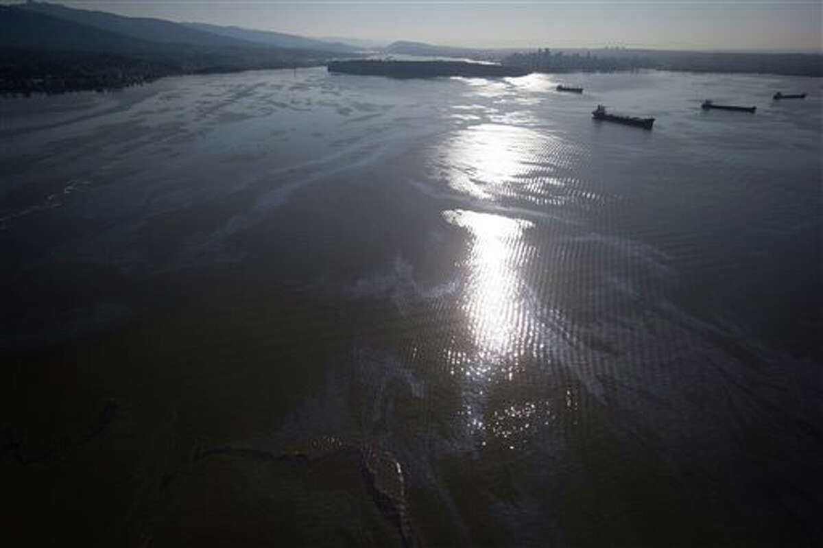 Fuel from the bulk carrier cargo ship Marathassa coats Burrard Inlet, Thursday, April 9, 2015, in Vancouver, British Columbia. The City of Vancouver warned that the fuel is toxic and should not be touched. (AP Photo/The Canadian Press, Darryl Dyck)