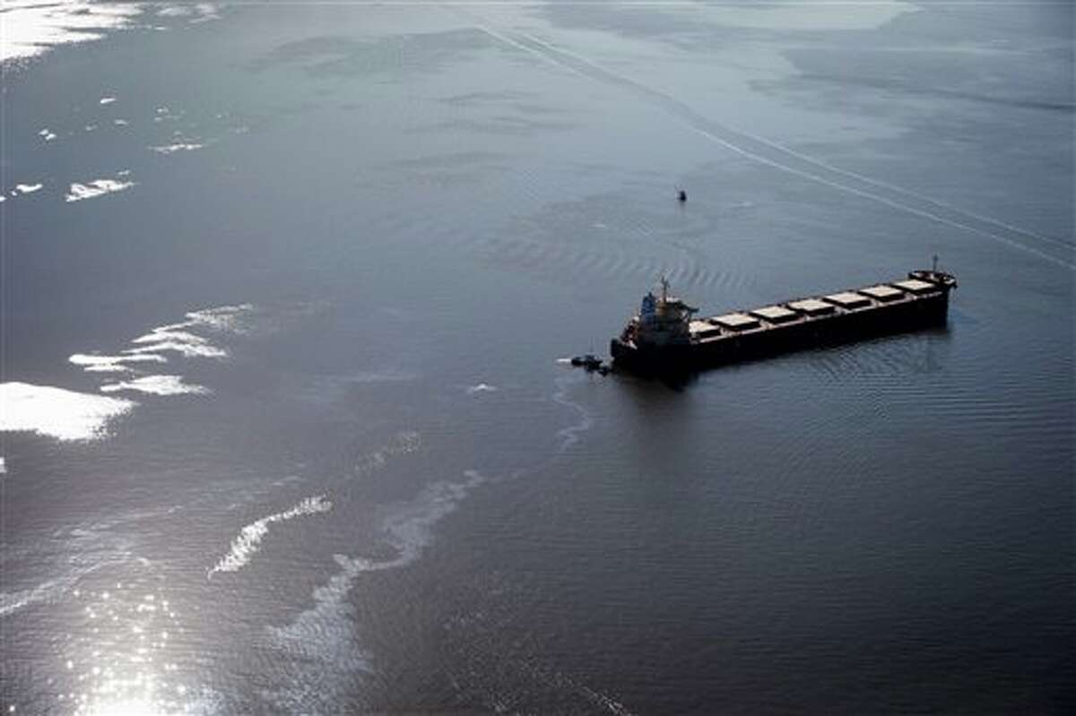 Fuel leaks from the bulk carrier cargo ship Marathassa, Thursday, April 9, 2015, in Vancouver, British Columbia. Slow cleanup allowed fuel to reach beaches in both Vancouver and West Vancouver. (AP Photo/The Canadian Press, Darryl Dyck)