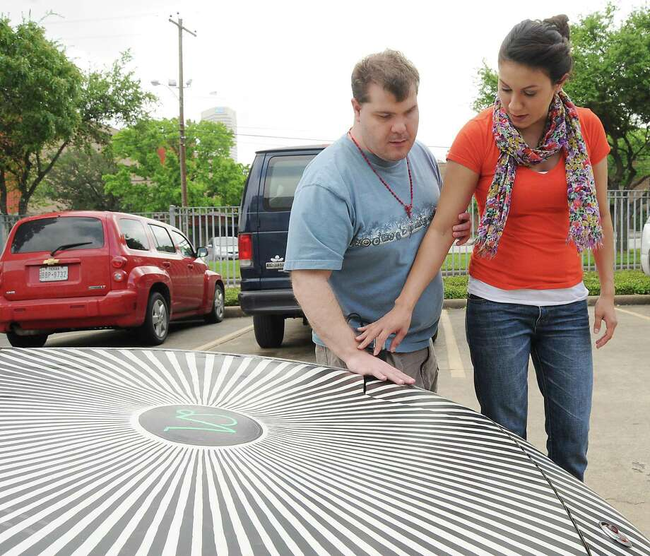 Recreational therapist Dana Solis, right, helps Alan Restivo feel Opti CAR lusion at The Lighthouse of Houston Thursday April 09, 2015. The cars are part of the Orange Show Center for Visionary Art's educational outreach program. Photo: Dave Rossman, For The Chronicle / Freelalnce