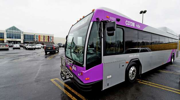 Capital District Transportation Authority bus with purple markings arrives at a press conference which called on Congress to support local transportation Thursday morning, April 9, 2015, at Crossgates Mall in Albany, N.Y.    (Skip Dickstein/Times Union) Photo: SKIP DICKSTEIN / 00031365A