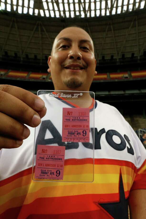 Alexander Luna holds an Opening Day ticket from 50 years ago at a celebration of the Astrodome's milestone birthday on April 9. Photo: Karen Warren, Houston Chronicle / © 2015 Houston Chronicle
