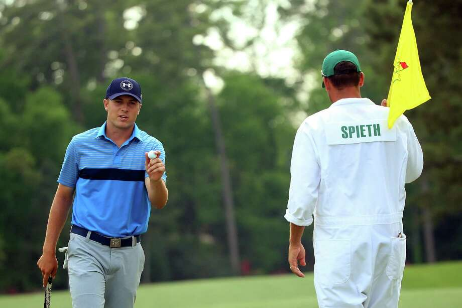 Jordan Spieth cards the eighth of his nine birdies at No. 14 during Thursday's first-round clinic. Photo: Andrew Redington, Staff / 2015 Getty Images