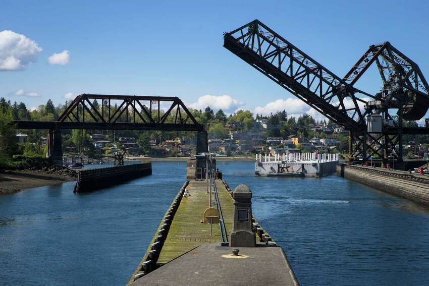The penultimate pontoon of the 520 bridge arrives at the Ballard Locks before making its way to Lake Washington on Thursday, April 9, 2015. The last three of the 77 pontoons needed to construct the world's largest floating bridge had been traveling since Monday from Aberdeen to Seattle.