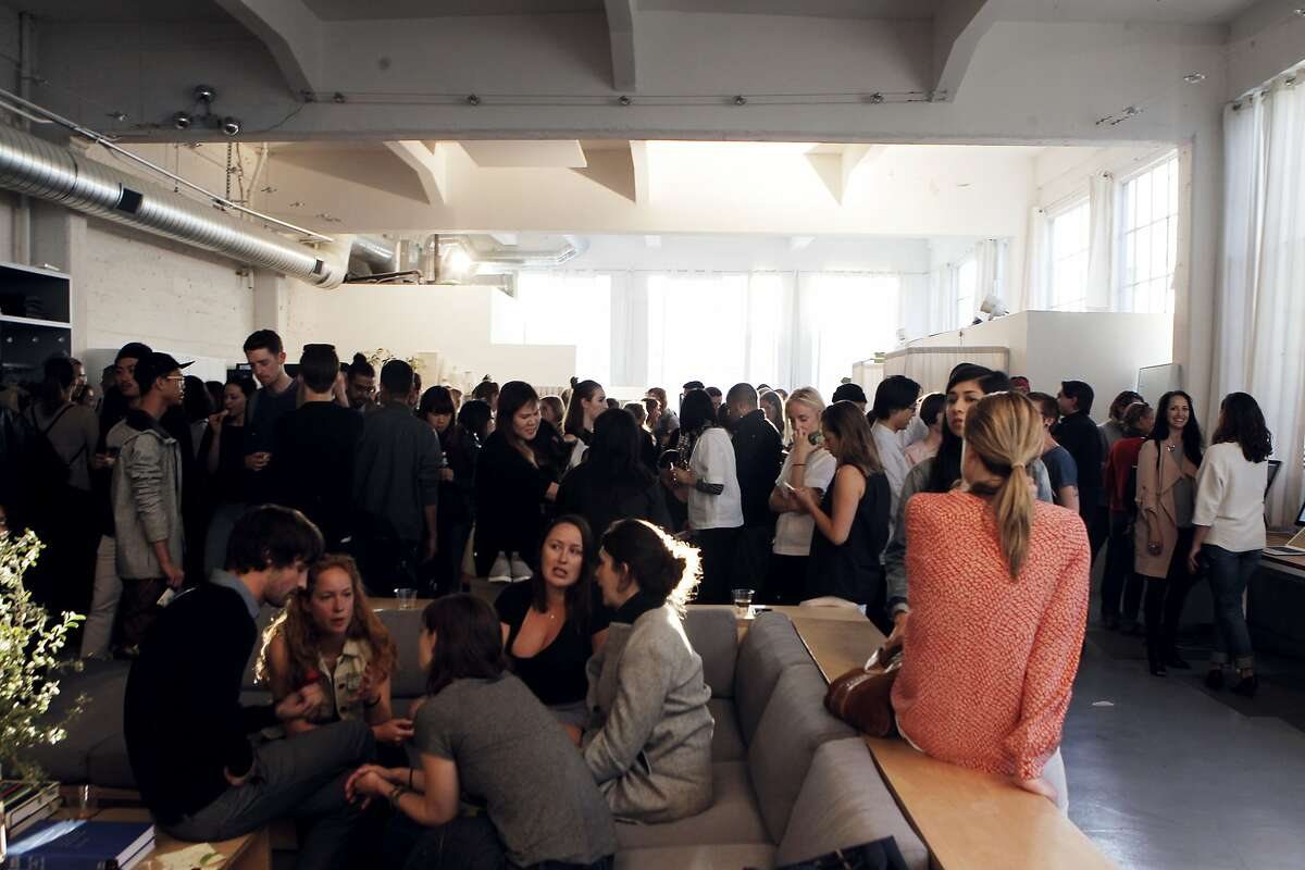 Customers socialize at the monthly open studio event at Everlane's office in San Francisco, Calif., Thursday April 9, 2015.
