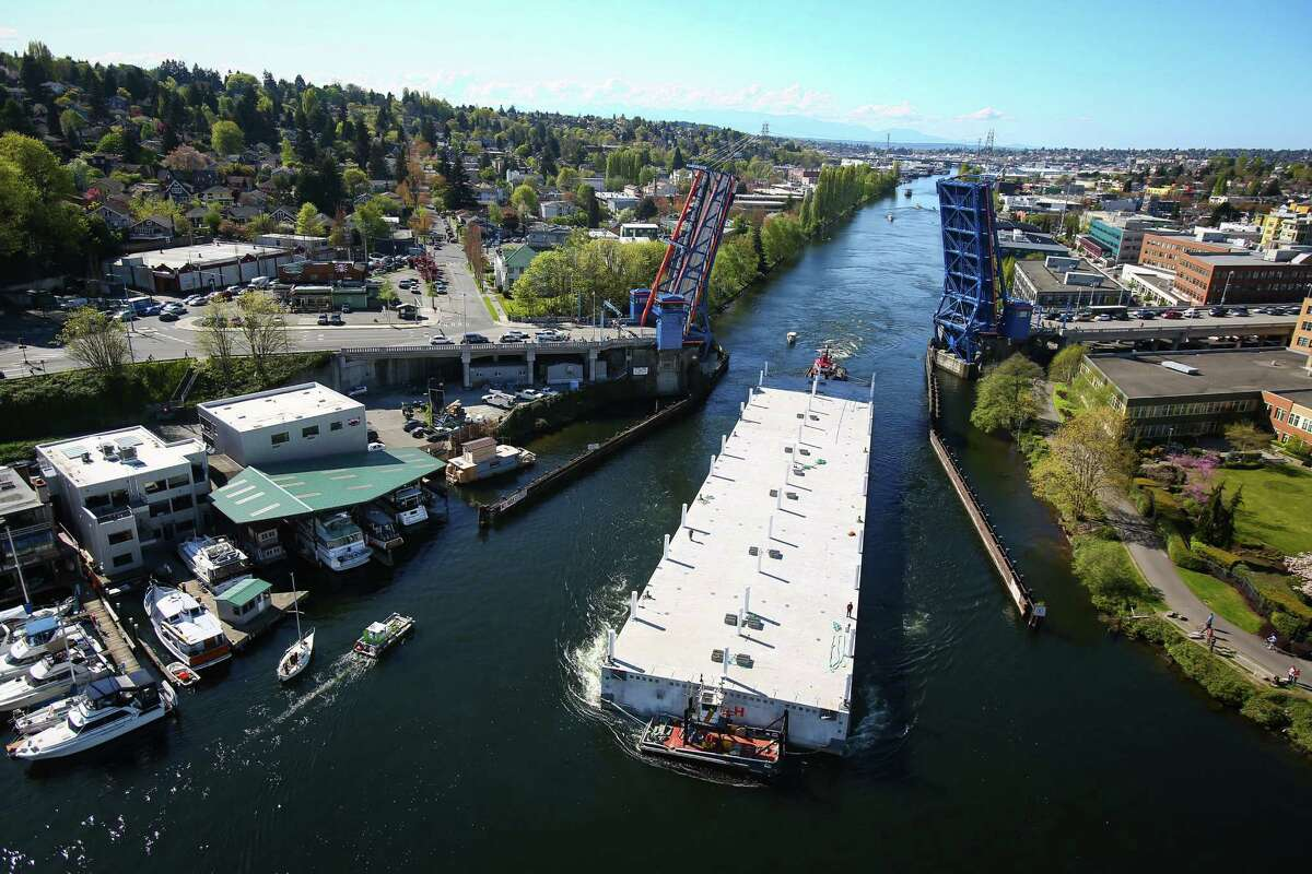 The penultimate pontoon of the 520 bridge passes under the Fremont Bridge while traveling to Lake Washington on Thursday, April 9, 2015. The last three of the 77 pontoons needed to construct the world's largest floating bridge had been traveling since Monday from Aberdeen to Seattle.