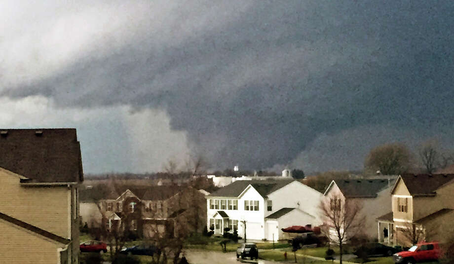 In this photo provided by Emily Mains, a tornado is viewed near Pearl Street from a home in the Kennedy's subdivision in Kirkland, Ill., on Thursday, April 9, 2015. One person was killed in the tiny community of Fairdale, James Joseph with the Illinois Department of Emergency Management said. Photo: Emily Mains, AP / via Daily Chronicle