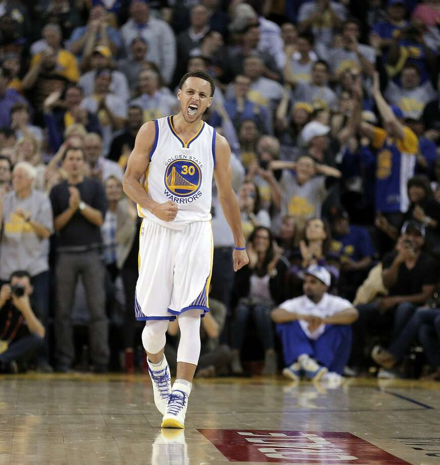 Stephen Curry (30) reacts after hitting a three point shot in the second half as the Golden State Warriors played the Portland Trail Blazers at Oracle Arena in Oakland, Calif., on  Thursday, April 9, 2015. Photo: Carlos Avila Gonzalez, The Chronicle