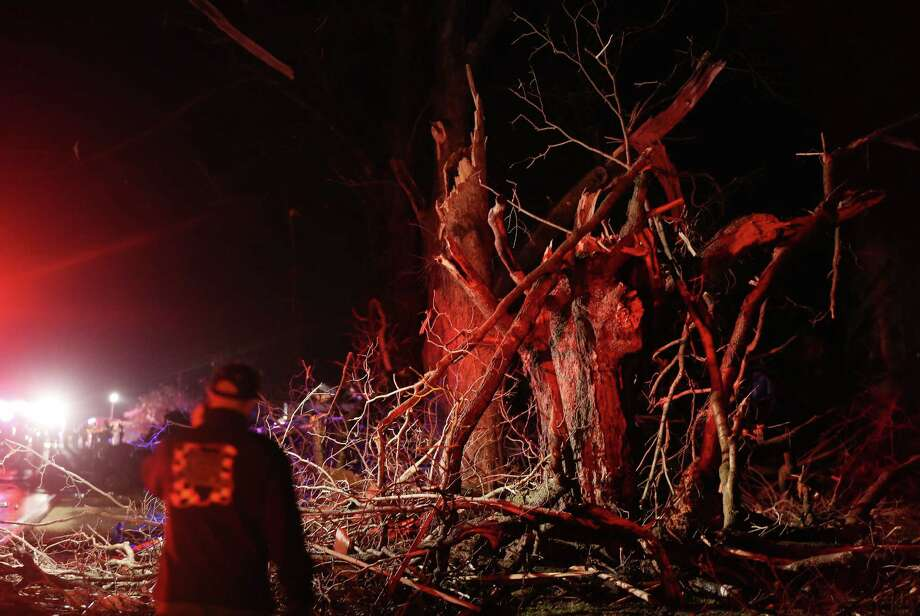 Trees are mangled on Highway 72 after a tornado in Fairdale, Illinois, Thursday, April 9, 2015. Supercell thunderstorms produced a large tornado that touched down Thursday night in northern Illinois, killing at least one person and injuring eight others in one tiny community as severe weather pummeled the Midwest.   (John J. Kim/Chicago Tribune) Photo: John J. Kim, AP / Chicago Tribune