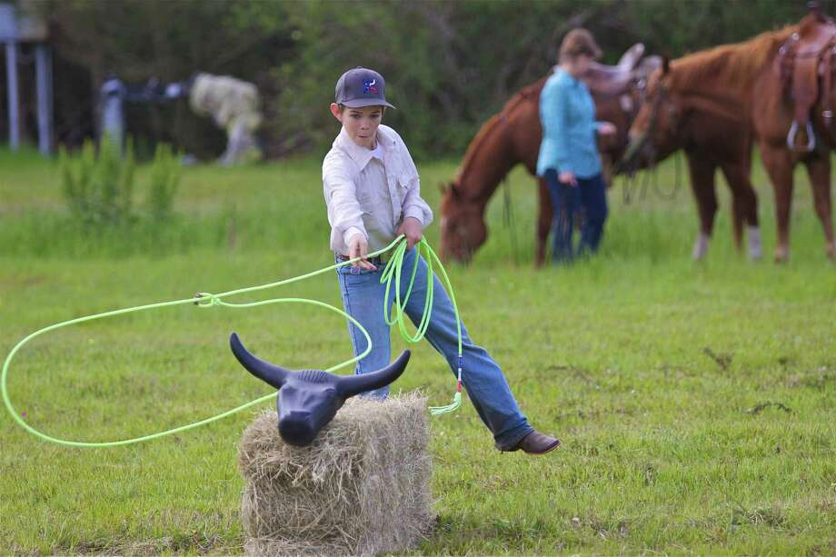 Girls and boys can practice lassoing skills at Katy Prairie Conservancy's Ranch Roundup. Photo: Trevor Skrhak