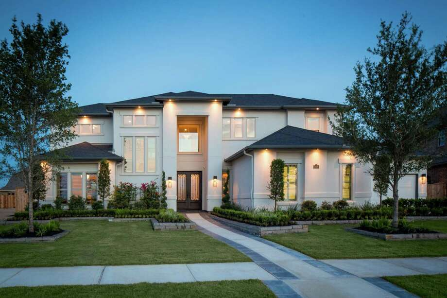 Cinco Ranch offers luxury homes by Partners In Building (shown) and Toll Brothers in Ironwood Estates, a gated enclave with waterfront homesites. / ©2013 Steve Chenn Photography