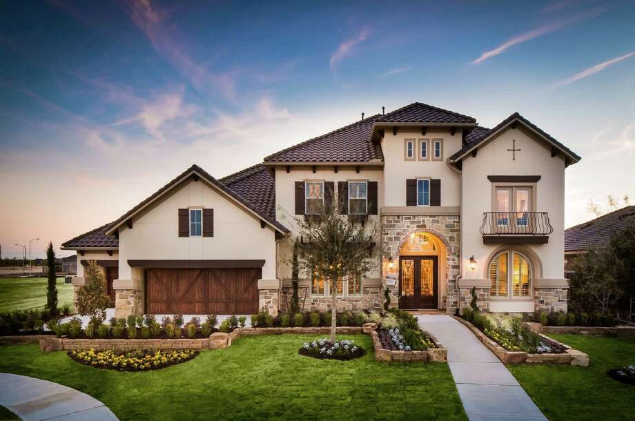 """The Johnson Development Corp. is again hosting """"Houston's Largest Home Tour,"""" opening the doors of more than 100 model homes and hundreds of available homes during weekends in April. With thousands of ideas to inspire the home decor enthusiast, the tour includes 10 communities throughout the Houston area. Tour maps can be downloaded at www.johnsondevelopment.com. / ©2013 Steve Chenn Photography"""