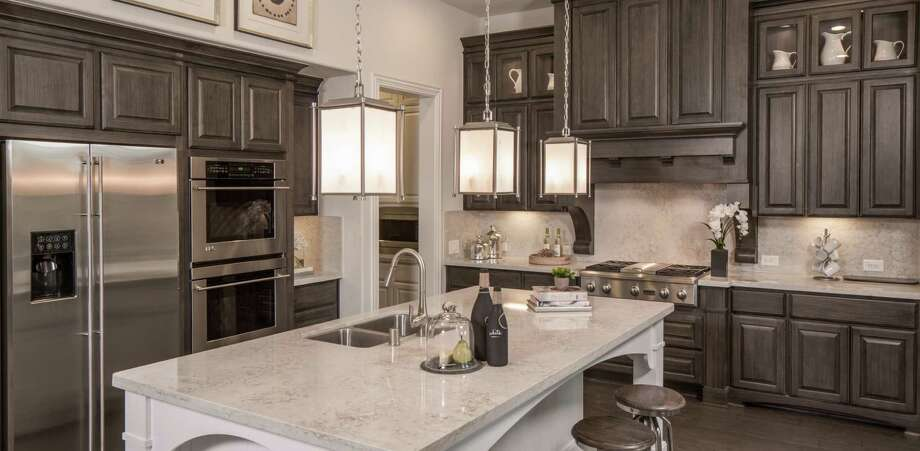 Highland Homes offers designs in more than 20 Houston-area developments. This month, new-home buyers can receive 50 percent off options up to $25,000 as well as closing cost discounts. / ©2014 Steve Chenn Photography