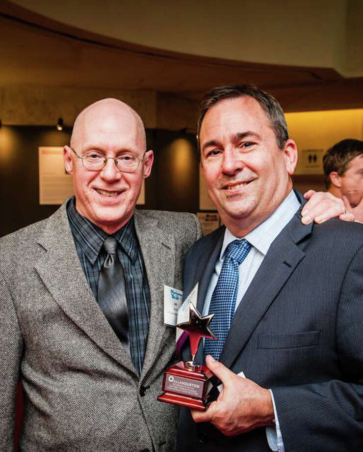 Jack Barnett (left), chief communications officer for the Harris County Appraisal District, celebrates with Bob Alban, vice president of marketing and communications for Coldwell Banker United, Realtors, honored as Houston's top real estate marketer during the American Marketing Association Houston Chapter 2014 Marketer of the Year Awards.