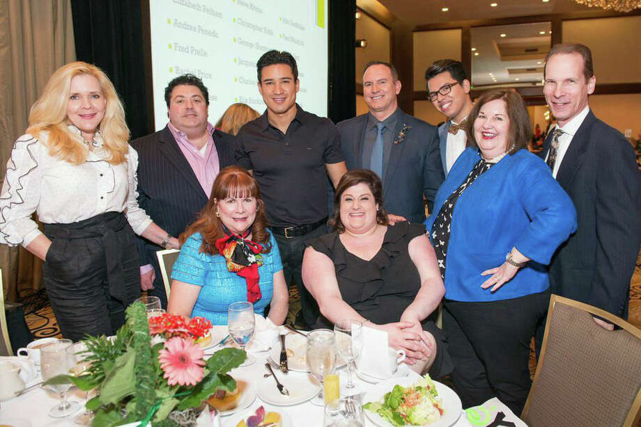 Shown are JDR sales associates Jeanine Kaminski-Ditzel, Nicholas Moncada, actor/host Mario Lopez, Richard Ray, Anthony Dowd, sales manager Debbie Youens and her husband, John. Sitting are Friends of JDR, Barbara Van Postman and Abby Lestin.