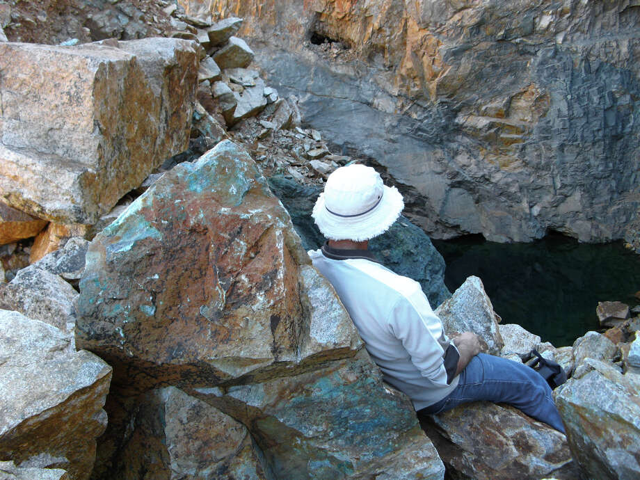 Many geologists spend a significant amount of their time in the field, at a proposed site. / iStockphoto