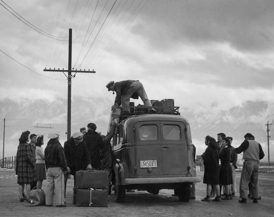 Loading bus, leaving Manzanar for relocation, Manzanar Relocation Center, California, 1943. Photo: Ansel Adams/Library Of Congress
