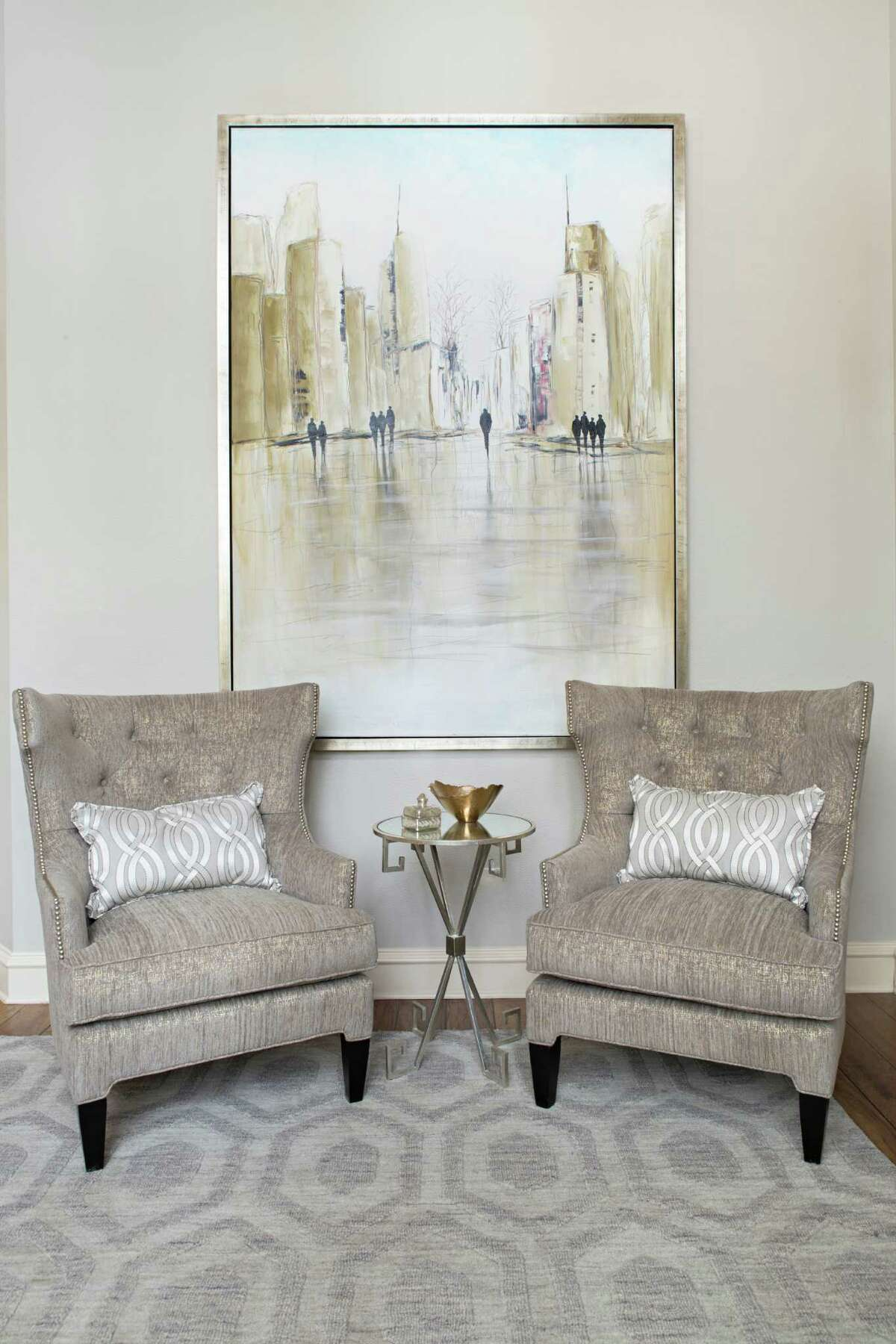 Behind the armchairs hangs a large painting Eck found in Dallas. The Liljas love New York City - it's where Jennifer was born - and they wanted to find a city scene that wouldn't darken the room.