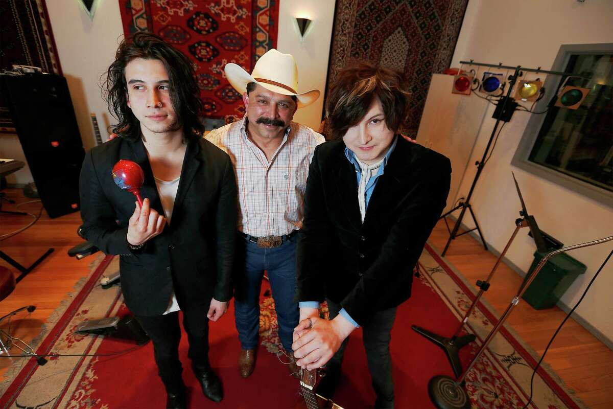 Famed Tejano singer Emilio Navaira (center) embraces his sons Diego (left) and Emilio, IV, and their love of music. The two brothers have a band, Ready Revolution, and will be performing at the annual St. Mary's University Oyster Bake. The trio visited M Studio owned by another well-known local musician Michael Morales on Wednesday, Apr. 1, 2015. (Kin Man Hui/San Antonio Express-News)