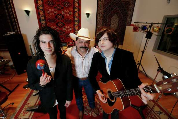Famed Tejano singer Emilio Navaira (center) embraces his sons Diego (left) and Emilio, IV, and their love of music. The two brothers have a band, Ready Revolution.