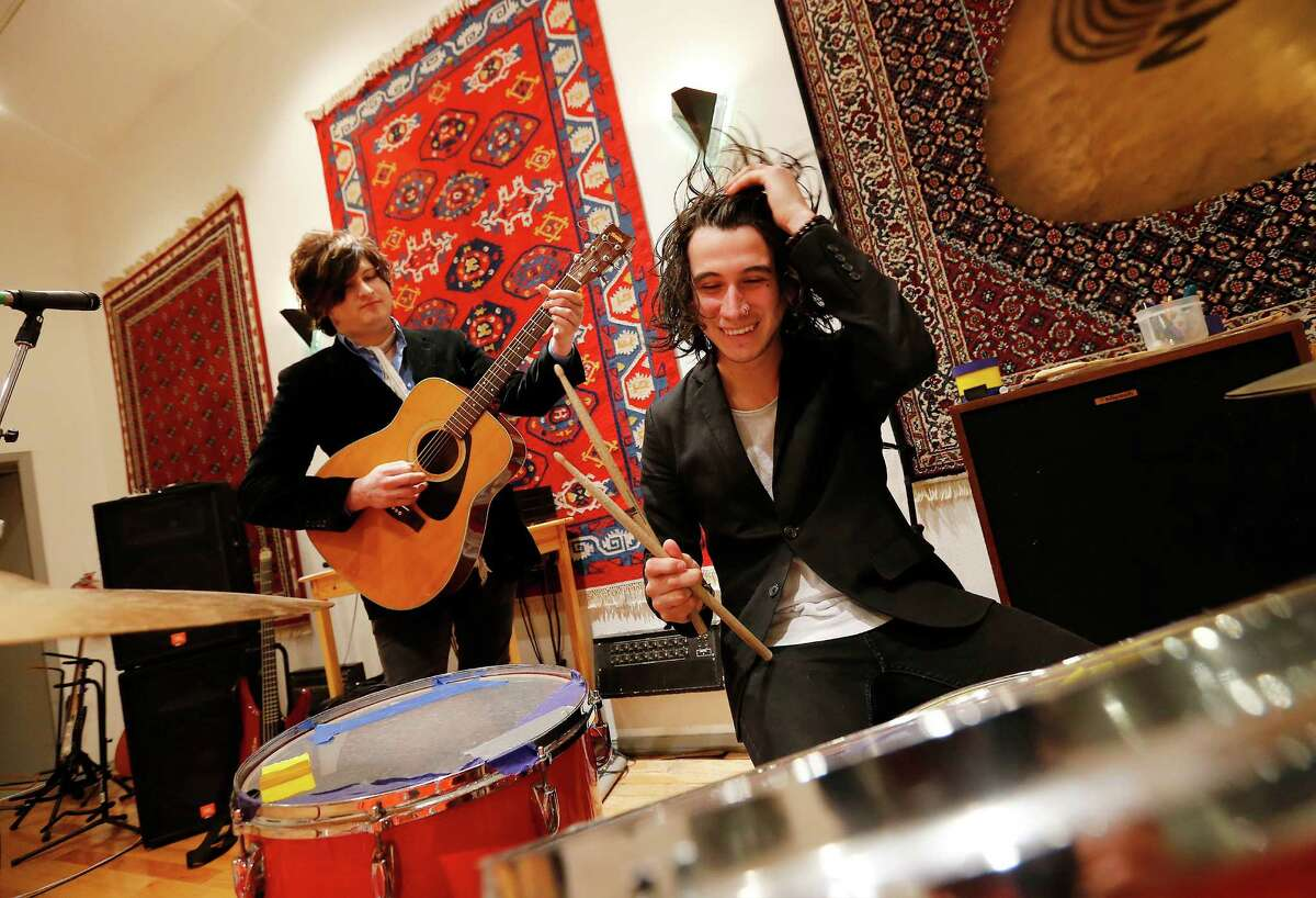 Emilio Navira IV (left) and his younger brother, Diego, joke around at Studio M.(