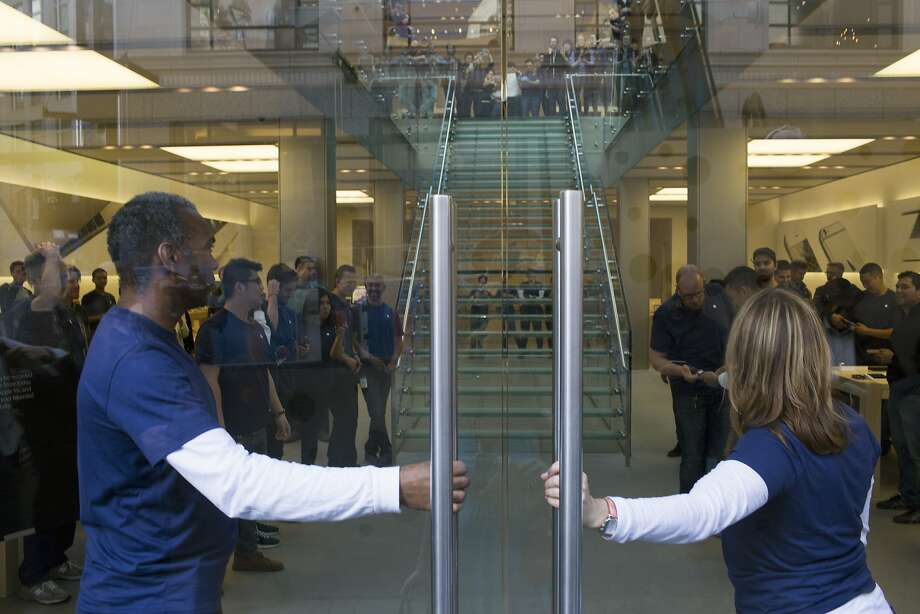 Apple employees prepare to open their doors for customers to try on the Apple Watch at the Apple Store in San Francisco, Calif. on Friday, April 10, 2015. Photo: Tim Hussin, Special To The Chronicle