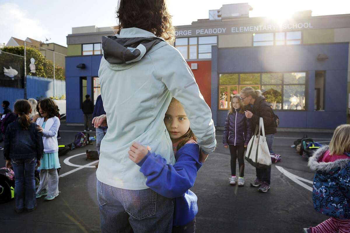 Parent Julie Brannegan hugs her daughter Piper Johnson, who is in kindergarten, during morning student drop-off at George Peabody Elementary School in San Francisco, CA, on Friday, April 10, 2015.