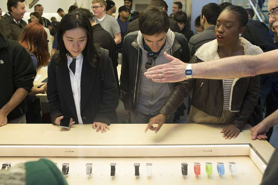 People look at a case displaying the Apple Watch at the Apple Store in San Francisco, Calif. on Friday, April 10, 2015. Photo: Tim Hussin, Special To The Chronicle