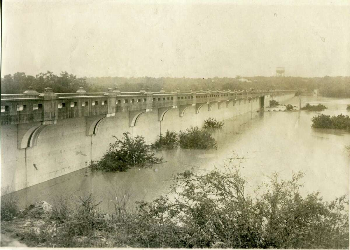 In this 1946 photograph of Olmos Dam, water had risen to 35 feet, 10 feet above what formerly had been called the danger line.