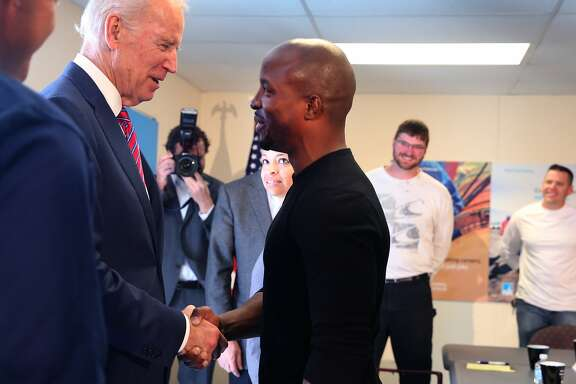 Vice President Joe Biden visits with Olando Jones IV, a veteran and a student in a PG&E Power Pathway class, a workforce development program, in Oakland, Calif. on Friday, April 10, 2015.