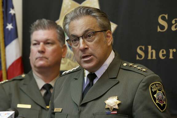 Sheriff Ross Mirkarimi (right) holds a press conference surrounded by  chief deputies including Matt Freeman (left) regarding investigations on the recent inmate escape in his office at City Hall in San Francisco, California, on Friday, April 10, 2015.
