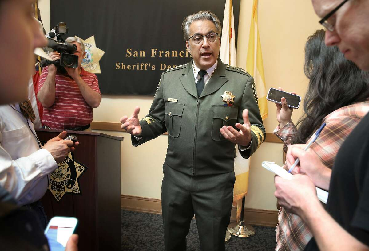 Sheriff Ross Mirkarimi (right) answers questions at a press conference regarding investigations on the recent inmate escape in his office at City Hall in San Francisco, California, on Friday, April 10, 2015.