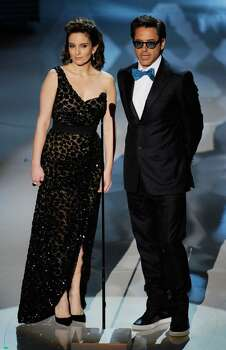 HOLLYWOOD - MARCH 07:  Actors Tina Fey and Robert Downey Jr. present onstage during the 82nd Annual Academy Awards held at Kodak Theatre on March 7, 2010 in Hollywood, California.  (Photo by Kevin Winter/Getty Images) *** Local Caption *** Tina Fey;Robert Downey Jr. Photo: Kevin Winter, Getty Images / 2010 Getty Images