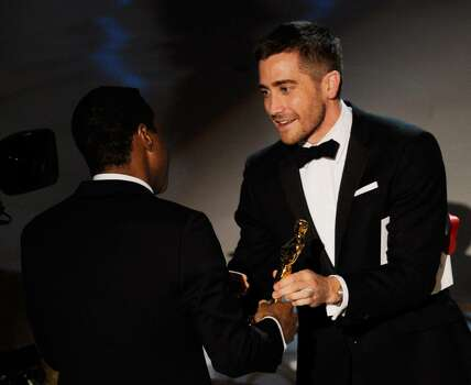 """HOLLYWOOD - MARCH 07:  Screenwriter Geoffrey Fletcher (L) accepts Best Adapted Screenplay award for """"Precious: Based on the Novel 'Push' by Sapphire"""" from presenter Jake Gyllenhaal onstage during the 82nd Annual Academy Awards held at Kodak Theatre on March 7, 2010 in Hollywood, California.  (Photo by Kevin Winter/Getty Images) *** Local Caption *** Geoffrey Fletcher;Jake Gyllenhaal Photo: Kevin Winter, Getty Images / 2010 Getty Images"""