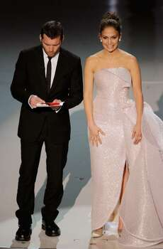HOLLYWOOD - MARCH 07:  Actors Sam Worthington and Jennifer Lopez present onstage during the 82nd Annual Academy Awards held at Kodak Theatre on March 7, 2010 in Hollywood, California.  (Photo by Kevin Winter/Getty Images) *** Local Caption *** Sam Worthington;Jennifer Lopez Photo: Kevin Winter, Getty Images / 2010 Getty Images