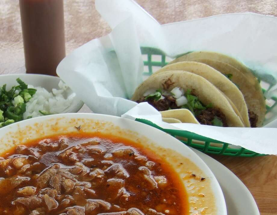 Tacos made with barbacoa - made the old-fashioned way with whole cow heads at Gerardo's Drive-in in Houston - are shown with another traditional Mexican dish, menudo, a soup made with cow stomach. Photo: J.C. Reid