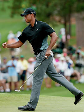 Tiger Woods celebrates a birdie on No. 7 during the second round of the Masters in Augusta, Ga. Despite shooting a 69, Woods is 12 shots off the lead.