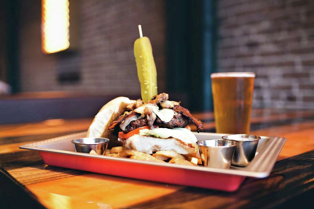 The Bovine Burger at Bovine & Barley: A 1/2 pound Angus beef burger topped with applewood smoked bacon and cheddar.