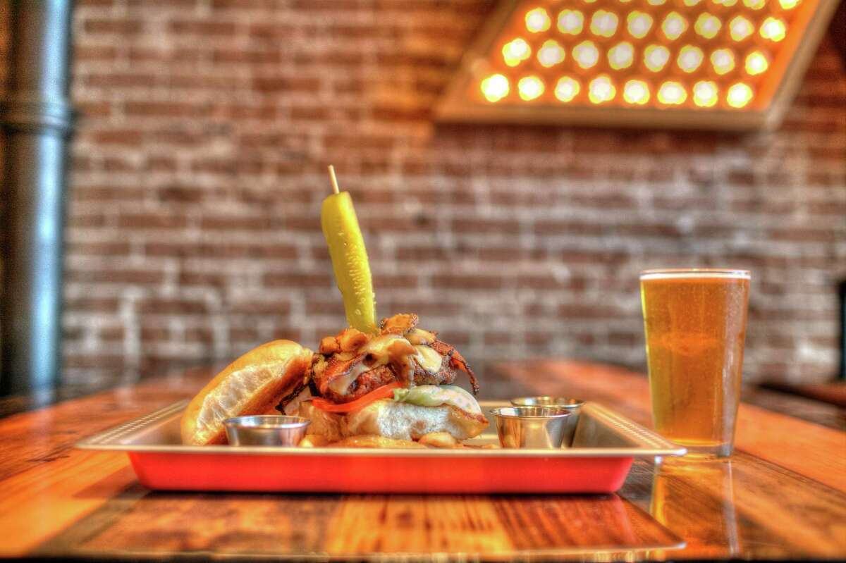The Bovine Burger is a half-pound Angus beef burger topped with applewood smoked bacon and cheddar.
