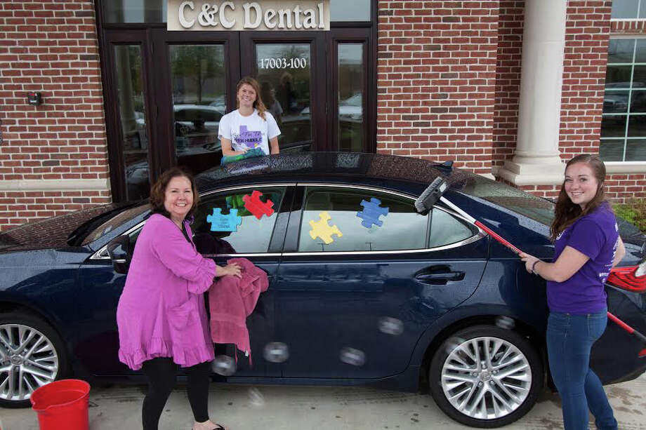 Dr. Teresa Cody, left, is one of the sponsors of the Car Wash For Kids on Sunday April 19, at C& C Dental, 17003 Southwest Freeway in Sugar Land, from 11 a.m. to 3 p.m.  Teens from area schools will be on hand to wash cars, free of charge.  Donations, however, are more than welcome, and all will go to Hope For Three.  Kirsten Overgaard, center back, and Courtney Kilfoy will be among the teens washing cars. Photo: Courtesy Hope For Three