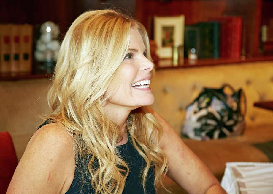 """Mariel Hemingway greets a guest while autographing her latest book, a memoir """"Out Comes the Sun"""" at the annual Family Centers luncheon benefit for Center for Hope at the Country Club of Darien on Wednesday. Photo: Contributed Photo / Greenwich Time Contributed"""