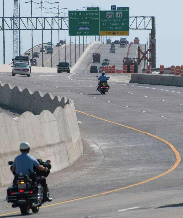Traffic flows across both spans of the Galveston Causeway in this 2008 file photo. A proposal is afoot to add the names of George and Cynthia Mitchell to the roadway. Photo: Steve Ueckert, Staff / Houston Chronicle