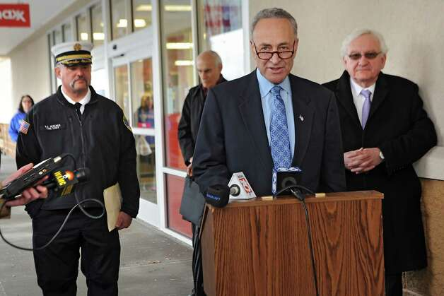 U.S. Senator Charles Schumer urges the Federal Emergency Management Agency (FEMA) to examine the outdated flood maps that have incorrectly placed the Johnstown Shopping Center, as well as up to 50 other properties in the surrounding area, in the Cayudutta CreekOs flood zone on Friday, April 10, 2015 in Johnstown, N.Y. Fire Chief Bruce Heberer stands at left and Johnstown Mayor Michael Julius stands at right. (Lori Van Buren / Times Union) Photo: Lori Van Buren / 00031385A